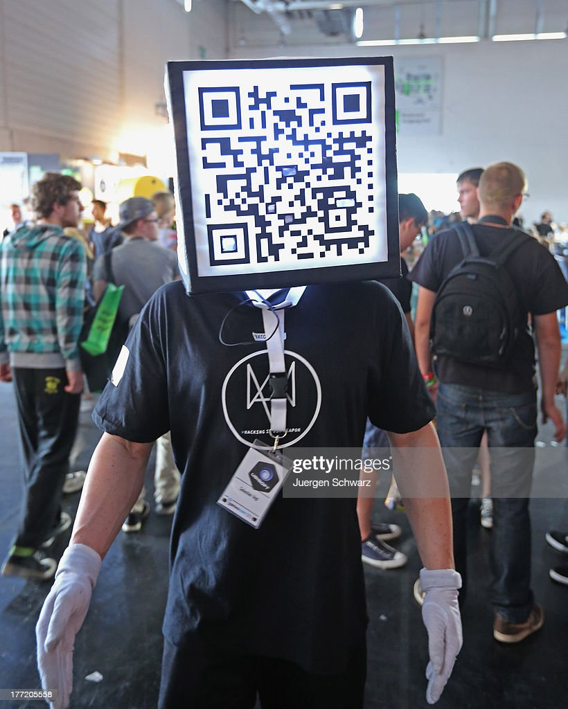 A promoter wears a QR code box at the Gamescom 2013 gaming trade air on August 22, 2013 in Cologne, Germany. Gamescom is the world's largest trade fair for digital gaming and will be open to the public from August 22-25.