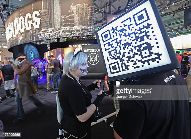 A promoter wears a QR code box at the Gamescom 2013 gaming trade air on August 22 2013 in Cologne Germany Gamescom is the world's largest trade fair...