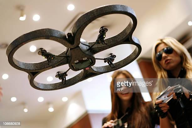 Promoters of the AR Drone quadricopter the first quadricopter controlled by an iPod Touch iPhone or IPad control the helicopter at Brookstone's...