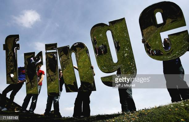 Promoters of the Edinburgh Fringe Festival hold up Fringe letters at Edinburgh Castle on June 8 2006 in Edinburgh ScotlandT he programme launch marks...