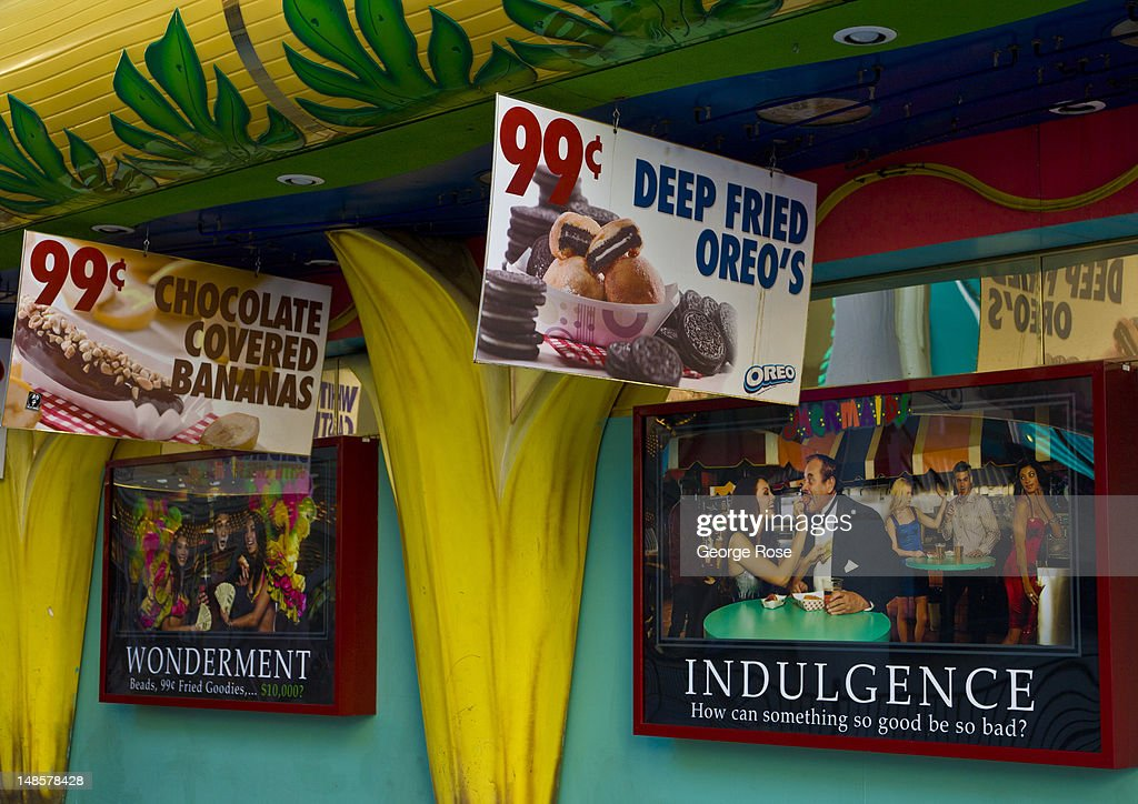 A promotion for deep fried Oreo cookies is viewed at the Fremont Street Experience on June 22, 2012 in Las Vegas, Nevada. Though tourism is slowly making a comeback on the Strip, the economic conditions just two blocks away remain in poverty.