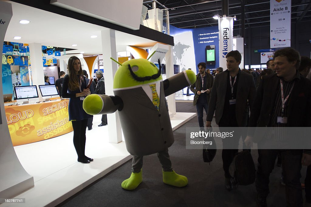 A promotional Android operating system character greets a visitor at the Mobile World Congress in Barcelona, Spain, on Tuesday, Feb. 26, 2013. The Mobile World Congress, where 1,500 exhibitors converge to discuss the future of wireless communication, is a global showcase for the mobile technology industry and runs from Feb. 25 through Feb. 28. Photographer: Angel Navarrete/Bloomberg via Getty Images