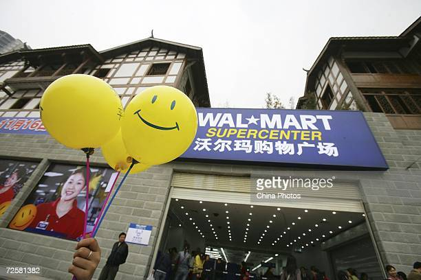 Promotional balloons are held outside Chongqing's second WalMart store which opened today November 16 2006 in Chongqing Municipality China...