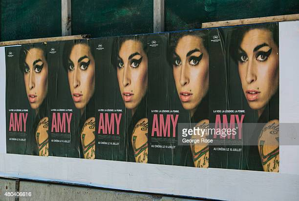 A promotional billboard for the new Amy Winehouse documentary film 'Amy' is posted on a wall in the Place des Arts plaza located on SainteCatherine...
