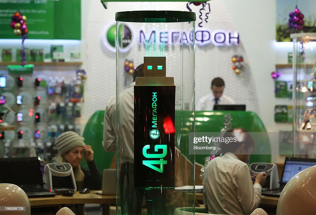A promotional display for 4G telecommunications stands inside an OAO MegaFon mobile phone store in Moscow, Russia, on Thursday, Dec. 13, 2012. OAO MegaFon and its main shareholder billionaire Alisher Usmanov bought 50 percent of Euroset Holding NV in a deal that gives Russia's biggest handset retailer an enterprise value of $2.3 billion. Photographer: Andrey Rudakov/Bloomberg via Getty Images