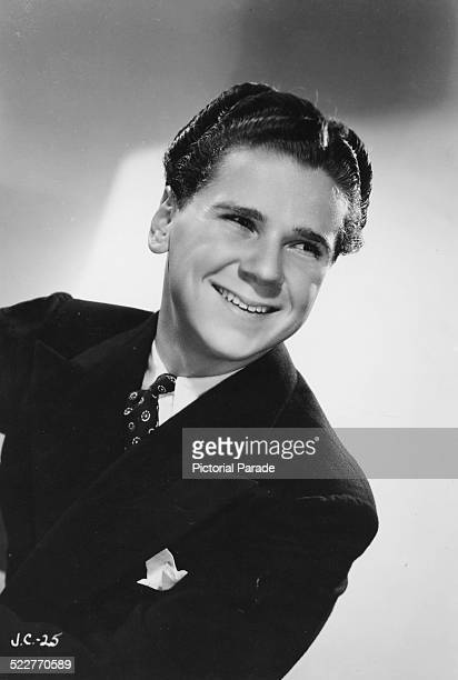 Promotional headshot of actor Jackie Cooper wearing a blazer with a pocket square circa 1938