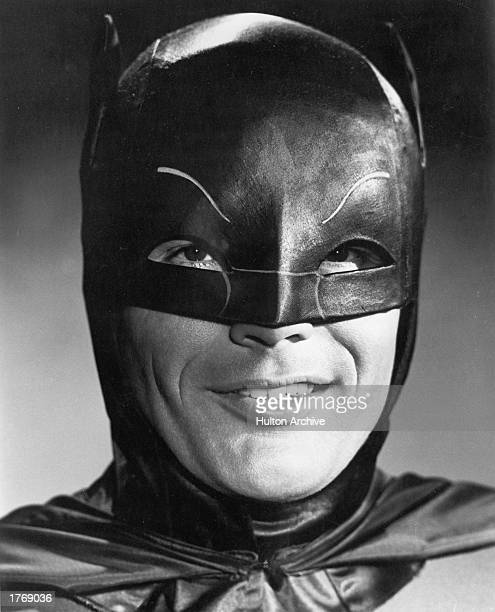 Promotional headshot portrait of American actor Adam West in costume as the title character from the television program 'Batman' c 1966 Photo by...