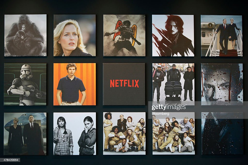 Promotional images of Netflix Inc programs are displayed on a wall at the Netflix Japan office in Tokyo Japan on Thursday June 25 2015 Netflix plans...