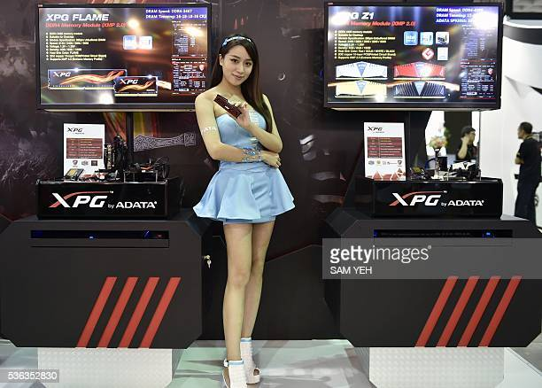 A promotional model poses with video game products during the annual Computex computer show in Taipei on June 1 2016 More than 5000 booth...