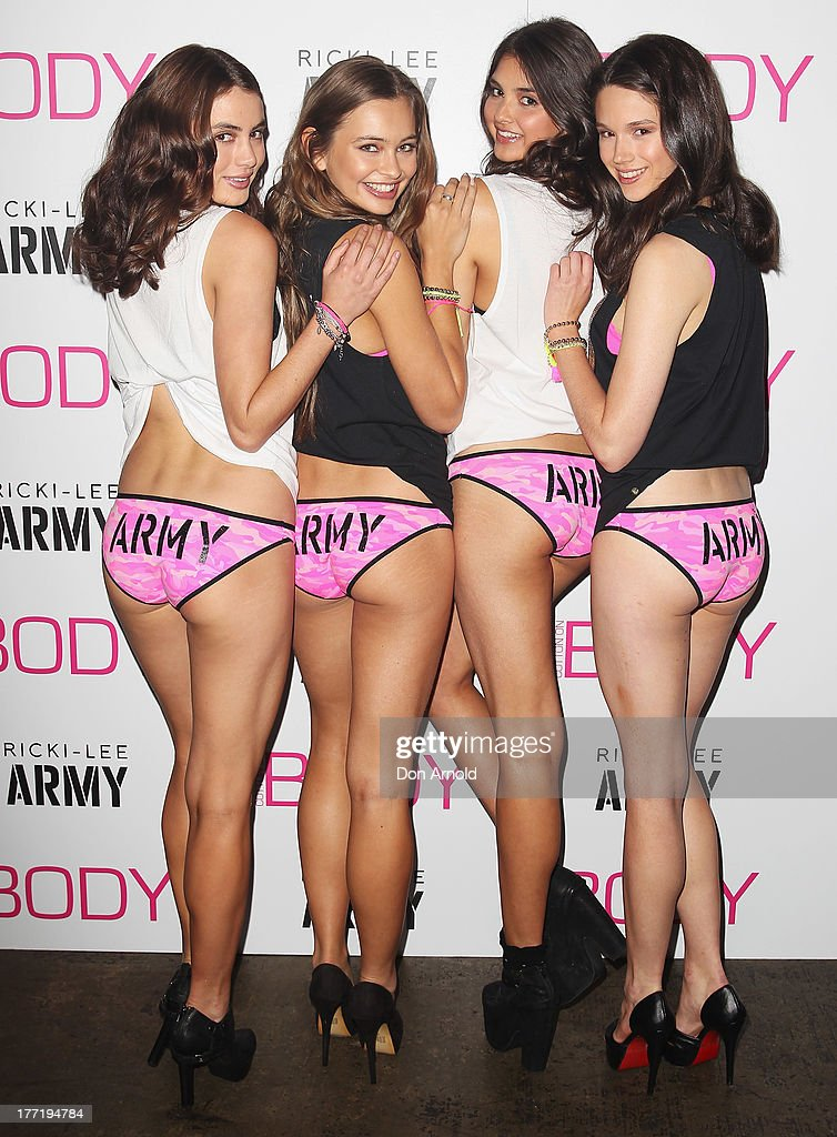 Promotional models pose at the launch of Ricky-Lee's collection for Cotton On Body at Simmer On The Bay, Hickson Road, Dawes Point on August 22, 2013 in Sydney, Australia.