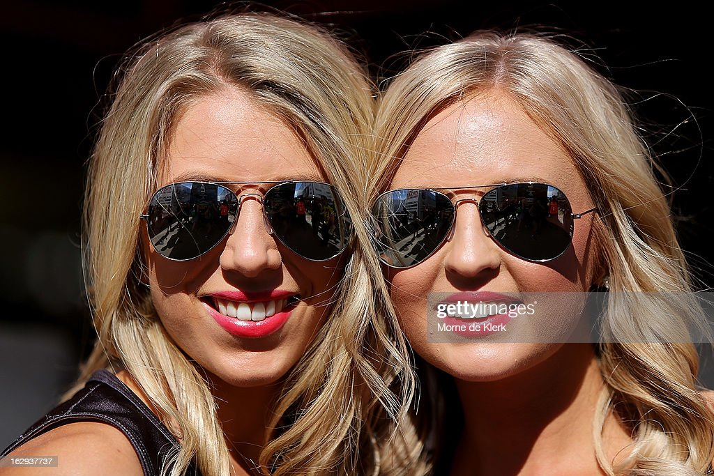Promotional models pose for photographs during the day before race one of the Clipsal 500, which is round one of the V8 Supercar Championship Series, at the Adelaide Street Circuit on March 2, 2013 in Adelaide, Australia.