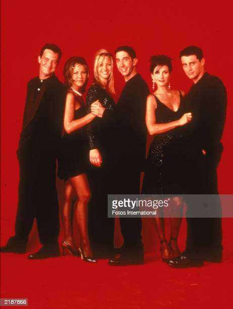 Promotional portait of the cast of the television series 'Friends' wearing black against a red backdrop circa 1995 LR Matthew Perry Jennifer Aniston...