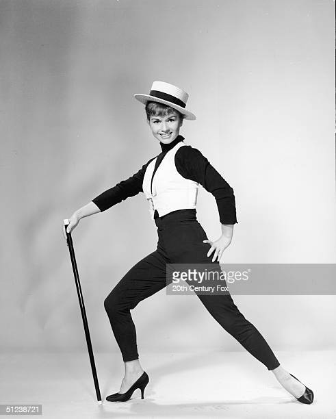 1959 Promotional portrait of American actor and singer Debbie Reynolds dancing with a cane for the film 'Say One For Me' directed by director Frank...