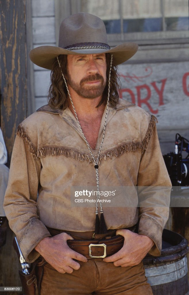 Promotional portrait of American actor Chuck Norris (as Cordell 'Cord' Walker) as he poses in a fringed shirt, gun belt, and stetson for an episode the television series 'Walker, Texas Ranger' entitled 'Last of a Breed,' 1997. The two-part episode was originally broadcast on November 1 and 8, 1997.