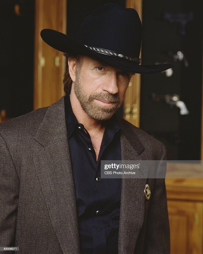 Promotional portrait of American actor Chuck Norris (as as Cordell 'Cord' Walker) dressed in a blazer over a black satin shirt and a black stetson, as he poses for the television series 'Walker, Texas Ranger,' 1997.