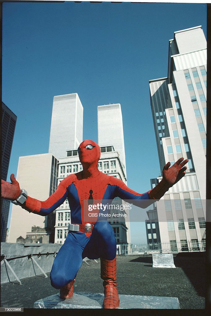 Promotional portrait of American actor Nicholas Hammond, as the costumed superhero Spider-man, as he crouches on the roof of a building near the World Trade Center, on the CBS television series 'The Amazing Spider-Man,' New York, New York, 1978. The series was based on a long-running comic book, developed by Stan Lee and Steve Ditko.