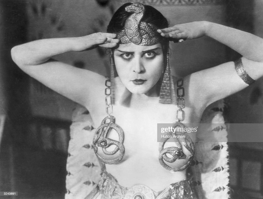 Promotional portrait of American actor Theda Bara (1885 - 1955) wearing an Egyptian headdress and breast plates with a snake design for director J Gordon Edwards' film, '<a gi-track='captionPersonalityLinkClicked' href=/galleries/search?phrase=Cleopatra&family=editorial&specificpeople=105315 ng-click='$event.stopPropagation()'>Cleopatra</a>'.