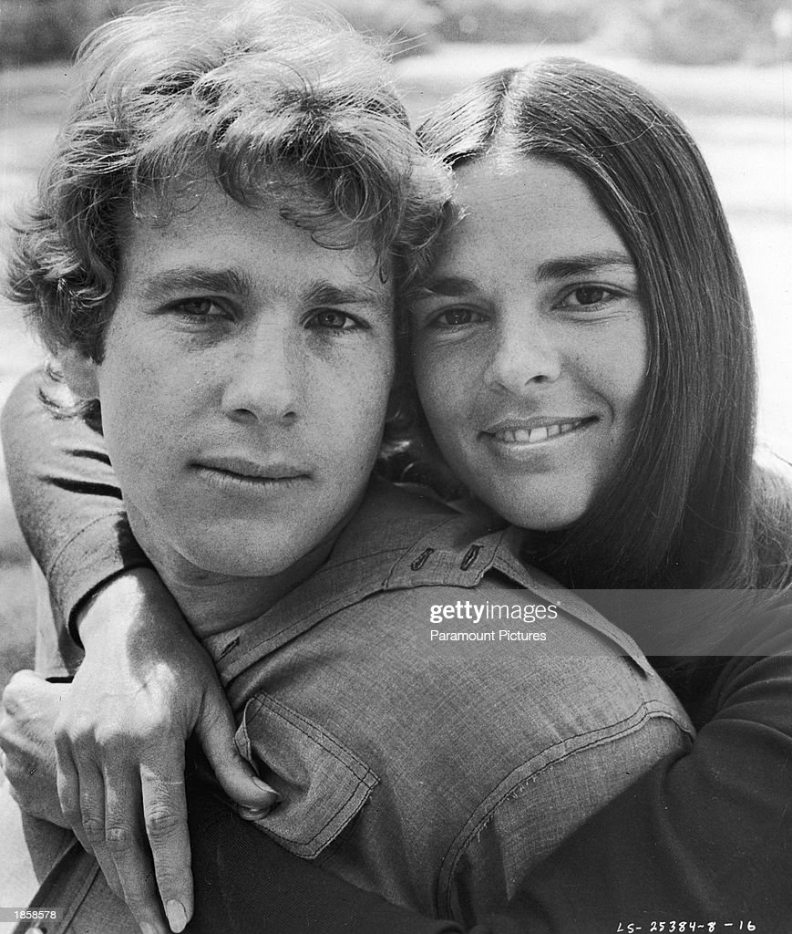Promotional portrait of American actors Ryan O'Neal and Ali MacGraw embracing for the film, 'Love Story,' directed by Arthur Hiller, 1970.