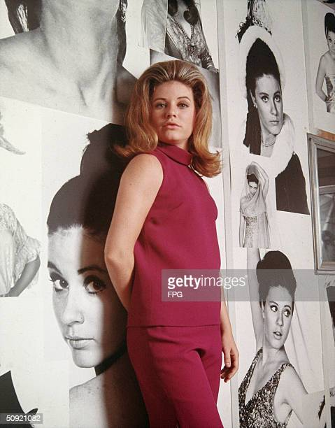 Promotional portrait of American actress Patty Duke in 'Valley Of The Dolls' directed by Mark Robson 1967 She leans against a wall covered in...
