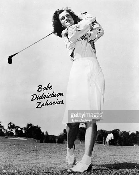 Promotional portrait of American golfer Babe Didrikson Zaharias posing on a golf course circa 1940s