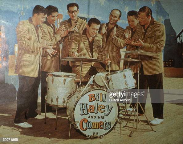 Promotional portrait of American rock and roll band Bill Haley His Comets as they wear matching jackets black pants and white shoes January 1957...