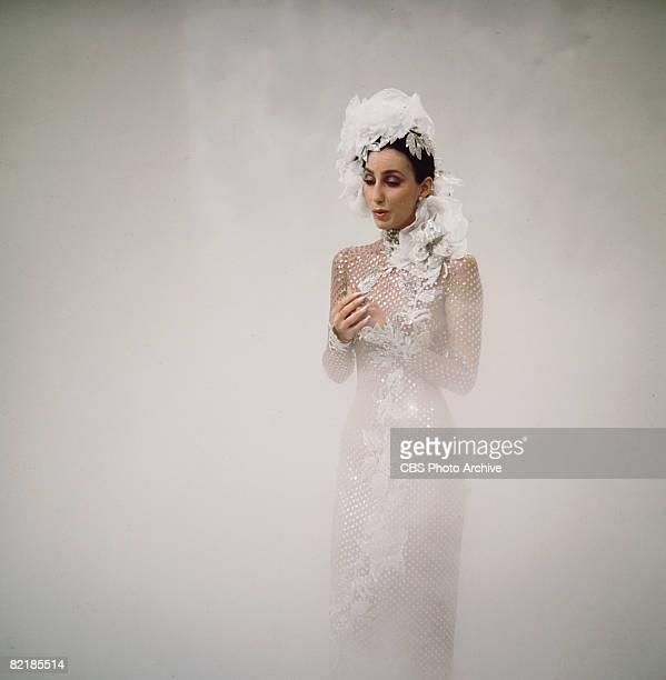 Promotional portrait of American singer and actress Cher as she sings from a cloud of fog for the television variety show 'The Sonny and Cher Comedy...