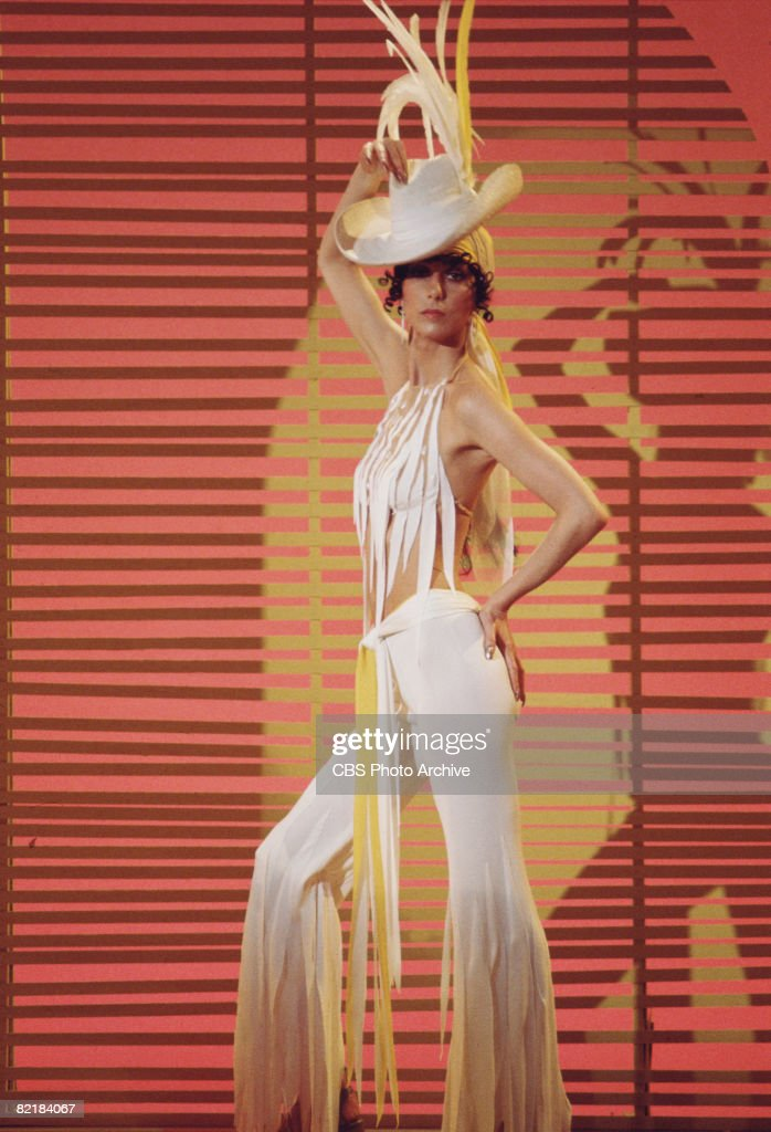 Promotional portrait of American singer and actress Cher (born Cherilyn Sarkisian LaPiere), dressed in fringed outfit, for the television variety show 'The Sonny and Cher Comedy Hour,' 1972.