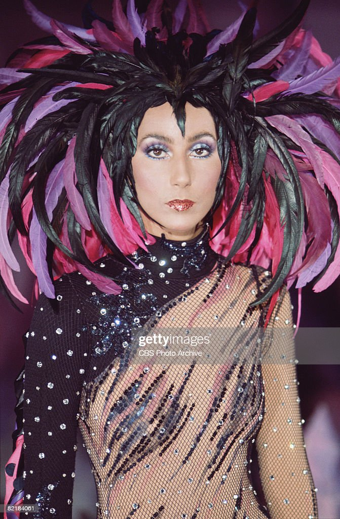 Promotional portrait of American singer and actress <a gi-track='captionPersonalityLinkClicked' href=/galleries/search?phrase=Cher+-+Performer&family=editorial&specificpeople=203036 ng-click='$event.stopPropagation()'>Cher</a> (born <a gi-track='captionPersonalityLinkClicked' href=/galleries/search?phrase=Cher+-+Performer&family=editorial&specificpeople=203036 ng-click='$event.stopPropagation()'>Cher</a>ilyn Sarkisian LaPiere) in a semi-transparent outfit with a feathered headdress for the television variety show 'The Sonny and <a gi-track='captionPersonalityLinkClicked' href=/galleries/search?phrase=Cher+-+Performer&family=editorial&specificpeople=203036 ng-click='$event.stopPropagation()'>Cher</a> Comedy Hour,' 1972.