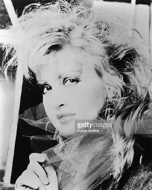 A promotional portrait of American singer Cyndi Lauper circa 1985