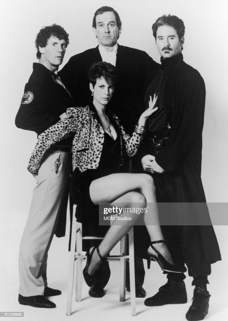 1988, Promotional portrait of British actors Michael Palin (left), John Cleese (centre), and American actor Kevin Kline posing behind American actor Jamie Lee Curtis for the film, 'A Fish Called Wanda,' directed by Charles Chichton.