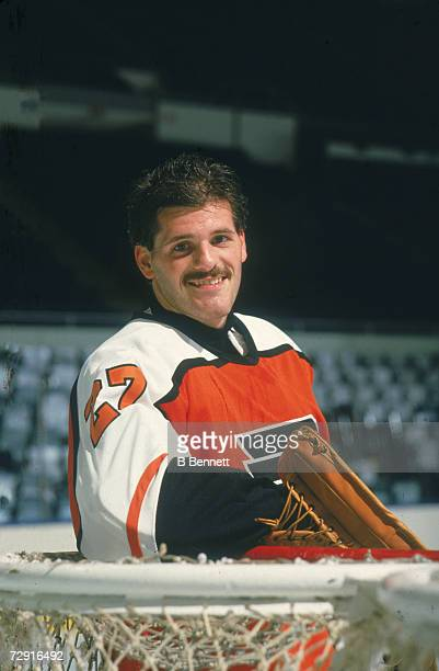 Promotional portrait of Canadian ice hockey player Ron Hextall goalkeeper for the Philadelphia Flyers as he leans against the net late 1990s