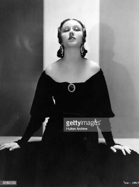Promotional portrait of Canadianborn actor Fay Wray wearing a black offtheshoulder gown with a brooch circa 1930