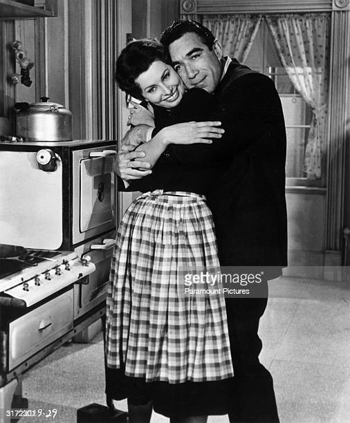 Promotional portrait of Mexicanborn actor Anthony Quinn hugging Italianborn actor Sophia Loren in a kitchen for director Martin Ritt's film 'The...