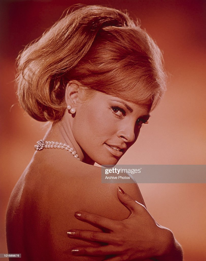 Promotional portrait of seemingly unclothed (save for a pearl necklace and matching earrings) American actress and sex symbol <a gi-track='captionPersonalityLinkClicked' href=/galleries/search?phrase=Raquel+Welch&family=editorial&specificpeople=203311 ng-click='$event.stopPropagation()'>Raquel Welch</a> (born Jo Raquel Tejada) as she poses with her arms around her shoulders and glances over her shoulder, 1960s.