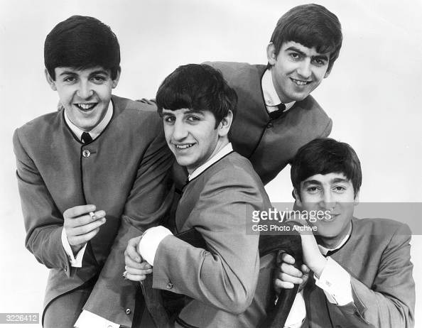 Promotional portrait of the British rock band The Beatles circa 1963 Paul McCartney holds a cigarette others are Ringo Starr George Harrison and John...
