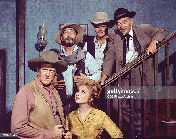 Promotional portrait of the cast of the American television series 'Gunsmoke' July 23 1969 Foreground American actors James Arness and Amanda Blake...