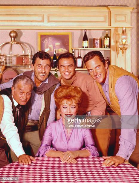 Promotional portrait of the cast of the American television series 'Gunsmoke' 1964 Seated is American actress Amanda Blake behind her from left...