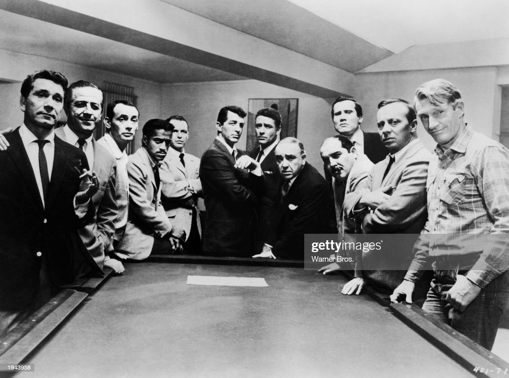 Promotional portrait of the cast of the film, 'Oceans 11'; (left - right): Richard Conte (1910 - 1975), Buddy Lester, (1907 - 1994), Joey Bishop, Sammy Davis Jr. (1925 - 1990), Frank Sinatra (1915 - 1998), Dean Martin (1917 - 1995), Peter Lawford (1923 - 1984), Akim Tamiroff (1899 - 1972), Richard Benedict (1920 - 1984), Henry Silva, Norman Fell (1924 - 1998), and Clem Harvey, 1960.