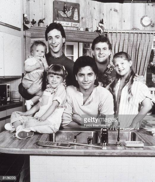 Promotional portrait of the cast of the television series 'Full House' LR Ashley or Mary Kate Olsen Bob Saget David Coulier Candace Cameron John...
