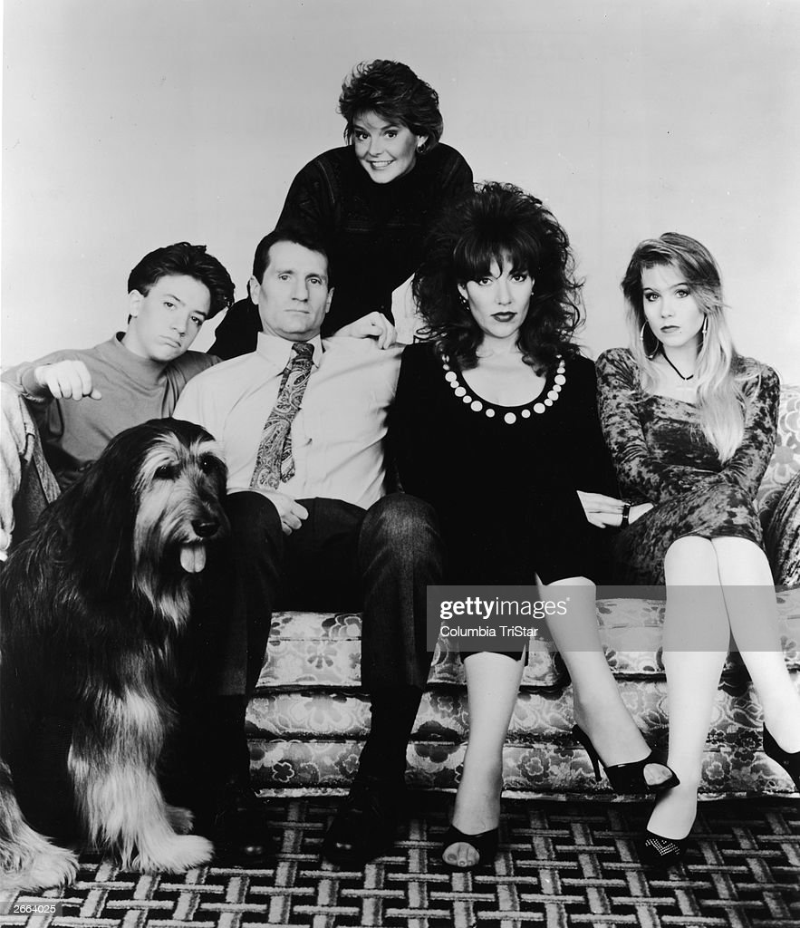 A promotional portrait of the cast of the television series 'Married With Children,' 1990. (L-R) David Faustino, Ed o'Neill, Katey Segal, Christina Applegate, and Amanda Bearse (standing at back).
