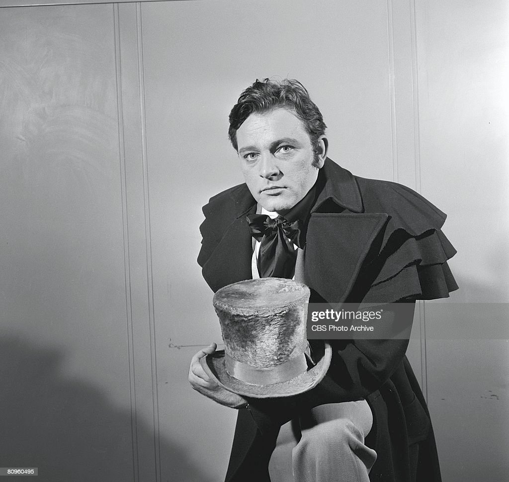 Promotional portrait of Welsh actor Richard Burton (1925 - 1984) as he poses with a top hat from 'The DuPont Show of the Month' television movie of Emily Bronte's novel 'Wuthering Heights,' April 21, 1958. Directed by Daniel Petrie, it was originally broadcast on May 9, 1958.
