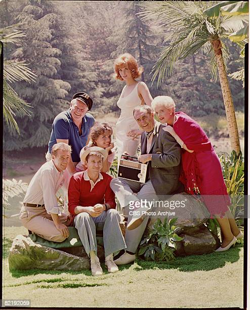 Promotional portrait shows the cast of 'Gilligan's Island' as they listen to a portable radio early 1960s Pictured are from left American actors...