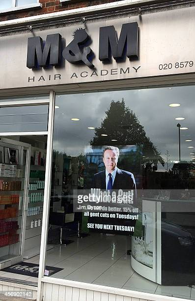 A promotional poster in the window of MM Hair Academy in South Ealing pokes fun at Prime Minister David Cameron following the Conservative Party...