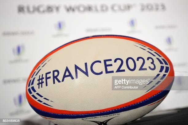 A promotional rugby ball sits on a table before a press conference by the French bid team after they presented their bid to host the 2023 Rugby World...