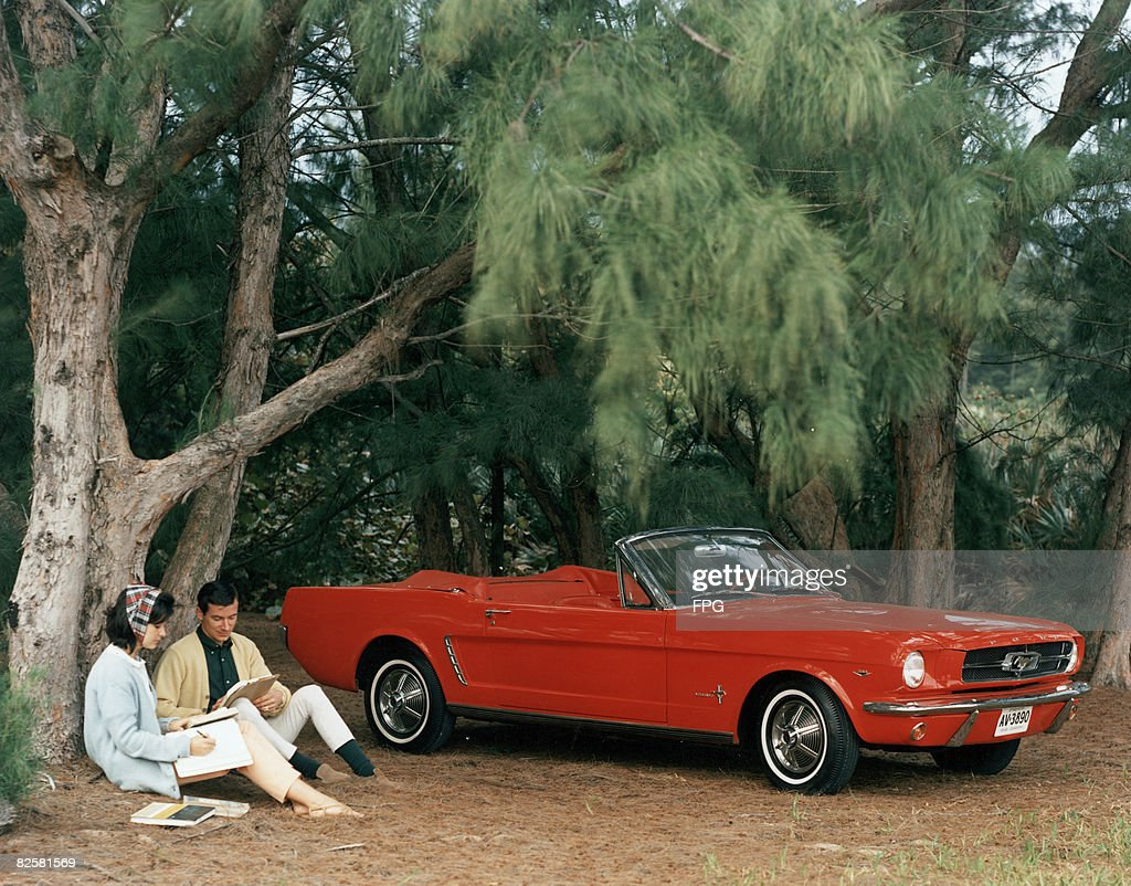 Promotional Shot Of Red 1964 Ford Mustang Convertible : Stock Photo