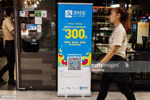 A promotional sign for Ant Financial Services Group's Alipay an affiliate of Alibaba Group Holding Ltd is displayed in Bangkok Thailand on Thursday...