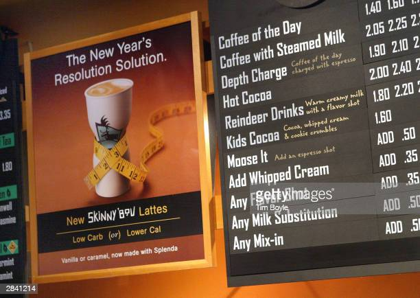 Promotional signage for new 'Skinny'Bou Lattes' reading 'The New Year's Resolution Solution' is visible at a Caribou Coffee store January 2 2004 in...