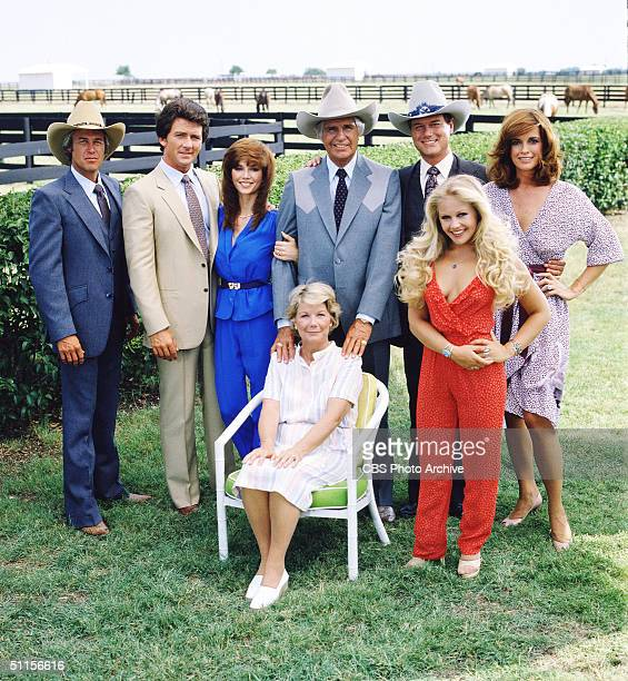 A promotional still from the American television series 'Dallas' shows the cast assembled on the property of the Southfork ranch on the outskirts of...