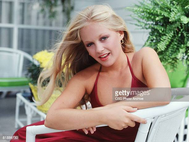 A promotional still from the American television series 'Dallas' shows Charlene Tilton as she leans across the arm of a chair September 1978
