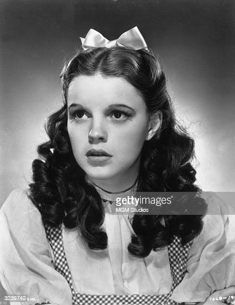 Promotional studio portrait of American actor and singer Judy Garland wearing her costume as Dorothy from director Victor Fleming's film 'The Wizard...